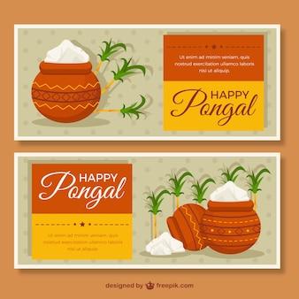 Flat pongal bannières avec la canne à sucre