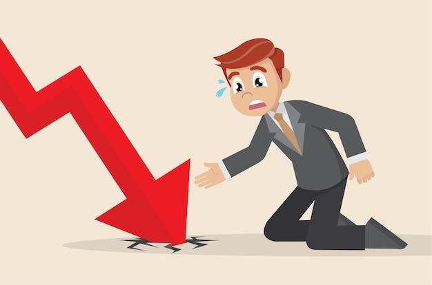 Flèche graphique descendant et homme d'affaires déprimé.