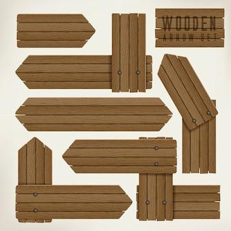 Flèches de plaque en bois sur fond beige