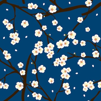 Fleur blanche fleur de prunier sur fond bleu indigo