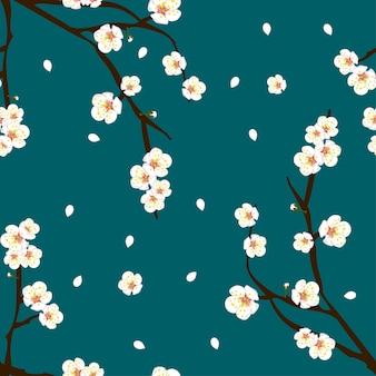 Fleur de fleur de prunier sur fond bleu indigo