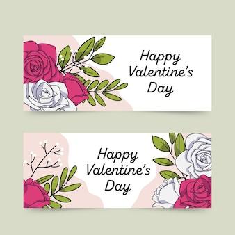 Fleurs et bannière de la saint-valentin dessinés à la main
