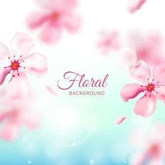 Fleurs de cerisier ou de sakura rose décorées sur fond bleu.
