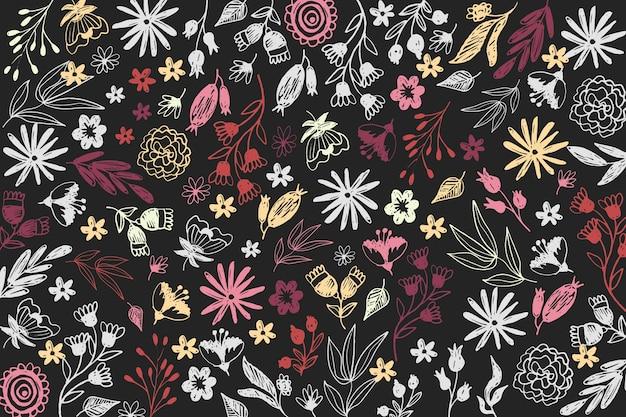 Fleurs colorées dessinées sur fond de tableau noir
