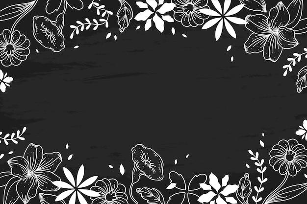 Fleurs dessinées à la main sur la conception du tableau noir