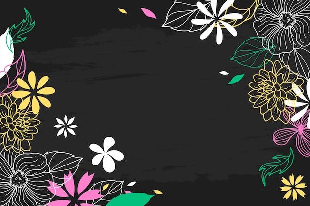 Fleurs dessinées à la main sur fond de tableau noir