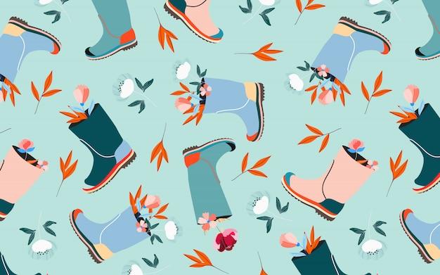 Fleurs en motif de bottes en caoutchouc. modèle sans couture de couleur pastel bleu aqua doux. ambiance printanière et arrangement floral de pâques. célébration des vacances de pâques. beau pour le web et l'impression.