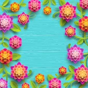 Fleurs en papier artificiel sur fond de planche de bois bleu