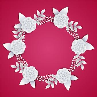Fleurs de papier blanc sur fond rose.