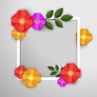 Fleurs en papier colorées avec cadre blanc.