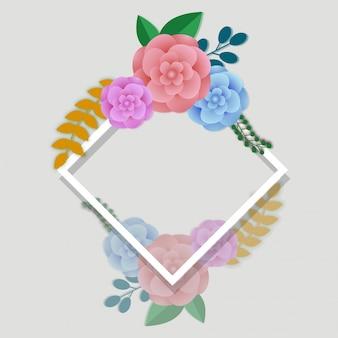 Fleurs en papier colorées avec un cadre carré blanc sur fond gris.