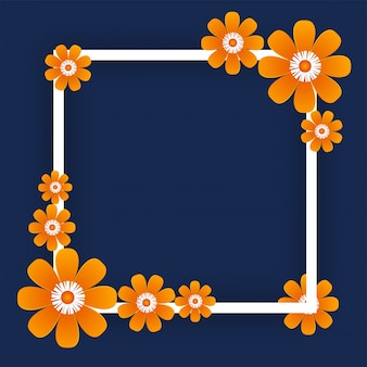Fleurs en papier orange avec cadre carré sur fond bleu.
