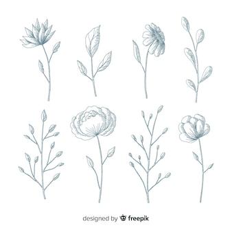 Fleurs réalistes dessinées à la main avec des tiges et des feuilles dans les tons bleus
