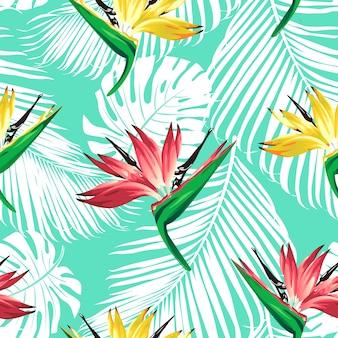 Fleurs tropicales et feuilles de palmier sur fond