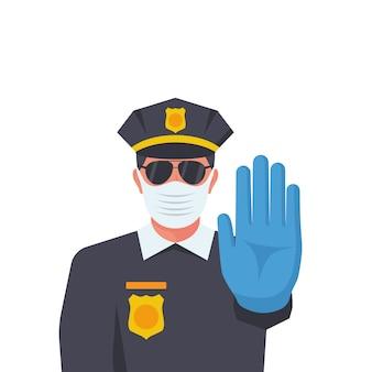 Un flic dans un masque de protection médicale et des gants en caoutchouc fait un geste d'arrêt avec sa main.