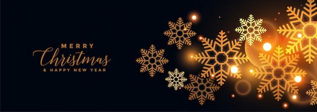 Flocons de neige dorés sur bannière noire joyeux noël