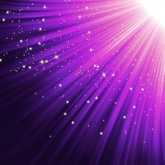 Flocons de neige et étoiles sur le chemin de la lumière rose.