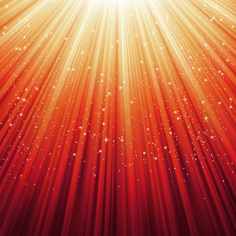 Flocons de neige et étoiles sur la lumière dorée.