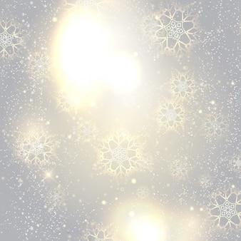 Flocons de neige sur un fond lumineux argent