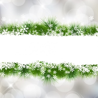 Flocons de neige de noël bokeh avec les feuilles