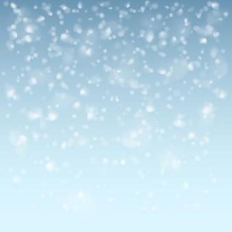 Flocons de neige tombant blancs sur fond bleu clair