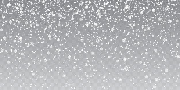 Flocons de neige tombant sur fond transparent