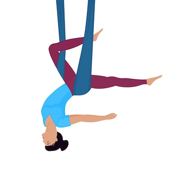 Fly yoga girl tête en bas dans un hamac.