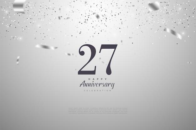 Fond de 27e anniversaire avec des chiffres et du papier argenté.