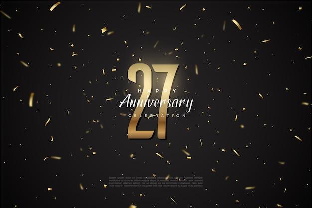 Fond de 27e anniversaire avec des chiffres et des taches d'or.