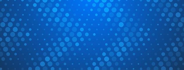 Fond abstrait demi-teinte fait de points de différentes tailles dans des couleurs bleues