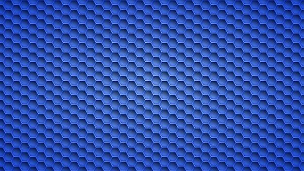 Fond abstrait en métal avec des trous hexagonaux dans des couleurs bleues