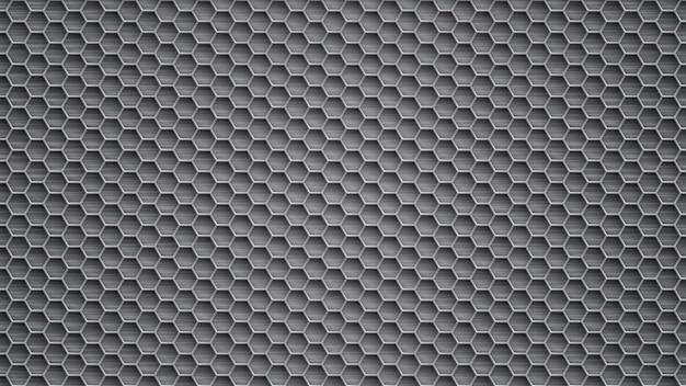 Fond abstrait en métal avec des trous hexagonaux dans des couleurs grises