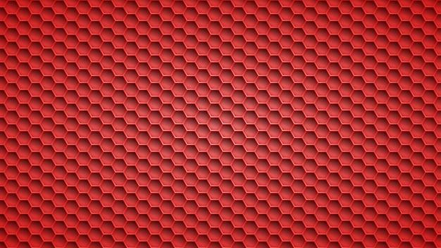 Fond abstrait en métal avec des trous hexagonaux dans des couleurs rouges