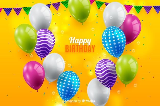Fond d'anniversaire avec des ballons colorés