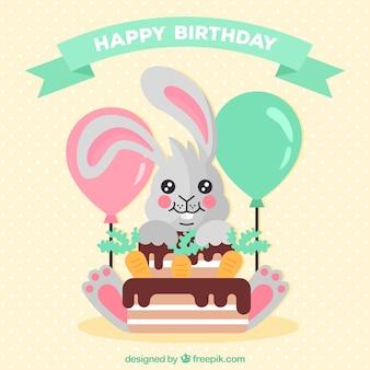 Fond d'anniversaire avec lapin et gâteau dans un design plat