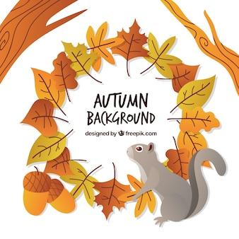 Fond d'automne avec des feuilles plates et l'écureuil
