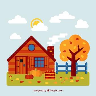 Fond d'automne avec une maison rouge