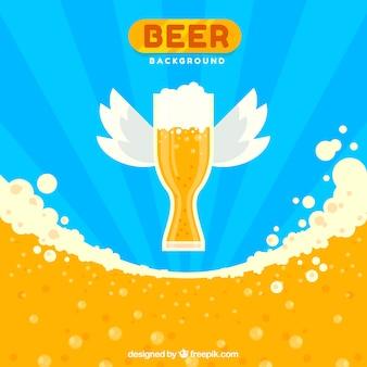 Fond de bière avec verre avec des ailes