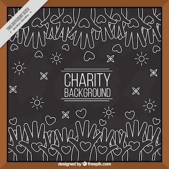 Fond blackboard de la charité avec les mains