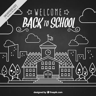 Fond blackboard de la main tiré en arrière à l'école