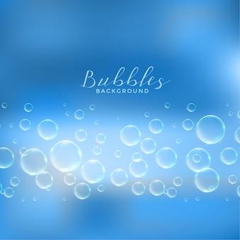 Fond bleu abstrait de bulles de savon ou d'eau