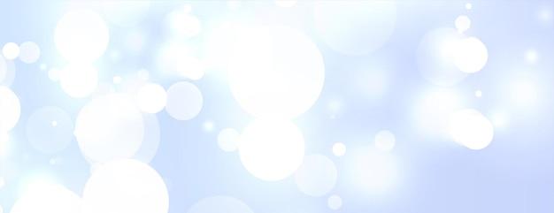 Fond bleu ciel avec effet de lumière bokeh