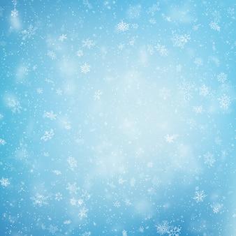 Fond bleu de flocons de neige de noël.