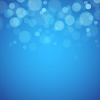 Fond bleu avec des lumières défocalisés