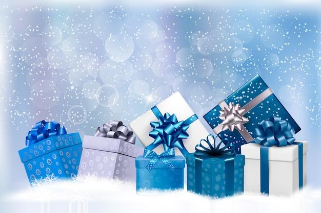 Fond bleu de noël avec coffrets cadeaux et flocons de neige.