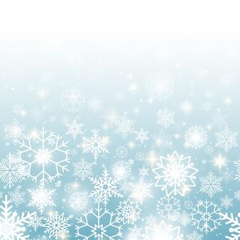 Fond bleu de noël avec motif transparent horizontal de flocons de neige