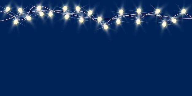 Fond bleu nuit de noël minimal avec des guirlandes de noël décoratives place pour le texte