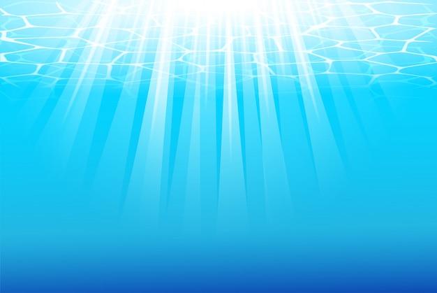 Fond bleu sous l'eau avec des rayons de soleil