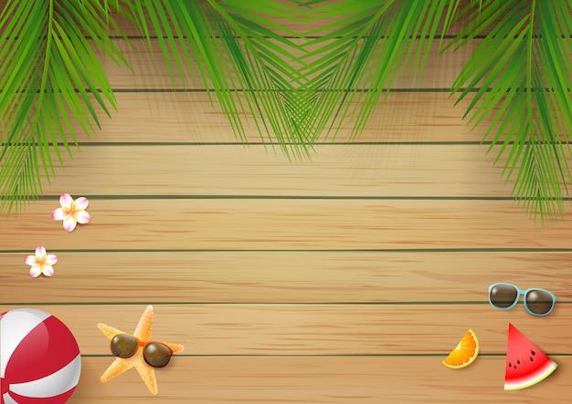 Fond en bois d'été avec des feuilles de palmier fraîches