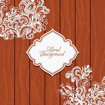 Fond en bois avec des fleurs et cadre